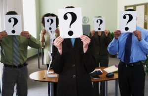 Office Workers with Question Mark Placards